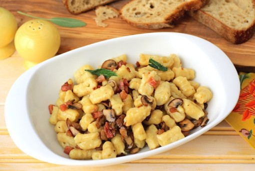 A serving bowl of Homemade Gnocchi with Pancetta, Mushrooms, and Sage is a delight