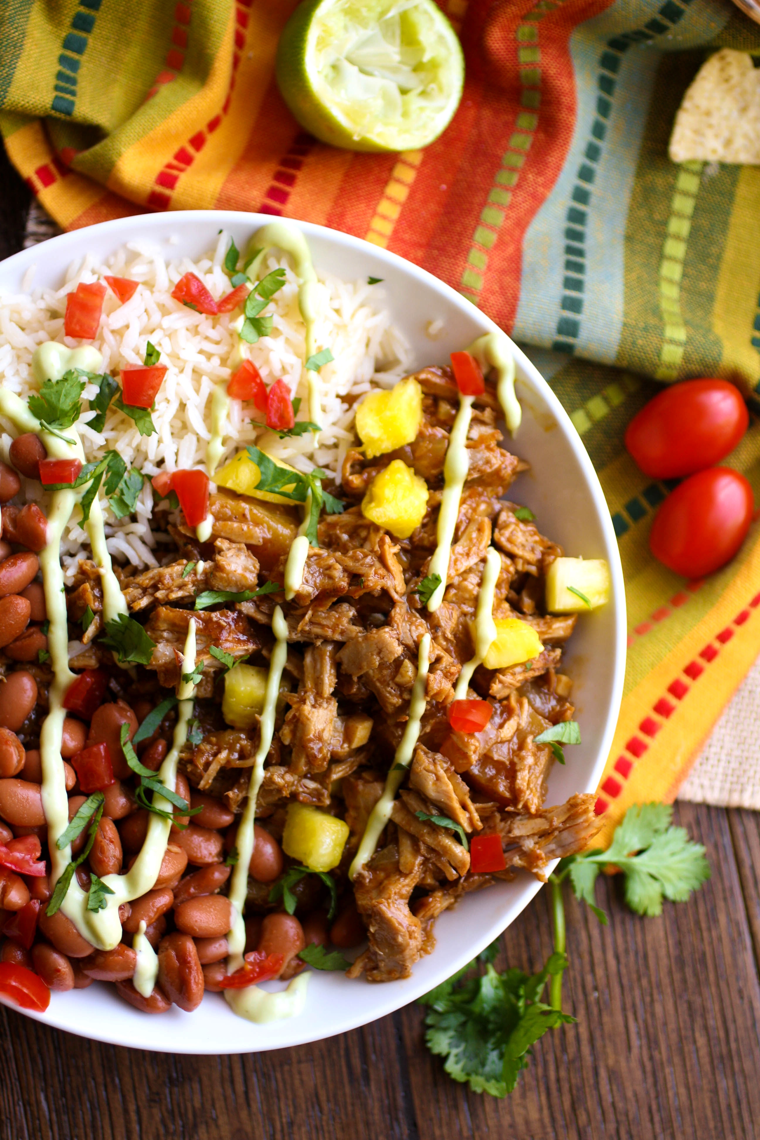 Pork al pastor bowls are amazingly delicious! You'll find rice, beans, and even pineapple in this dish.