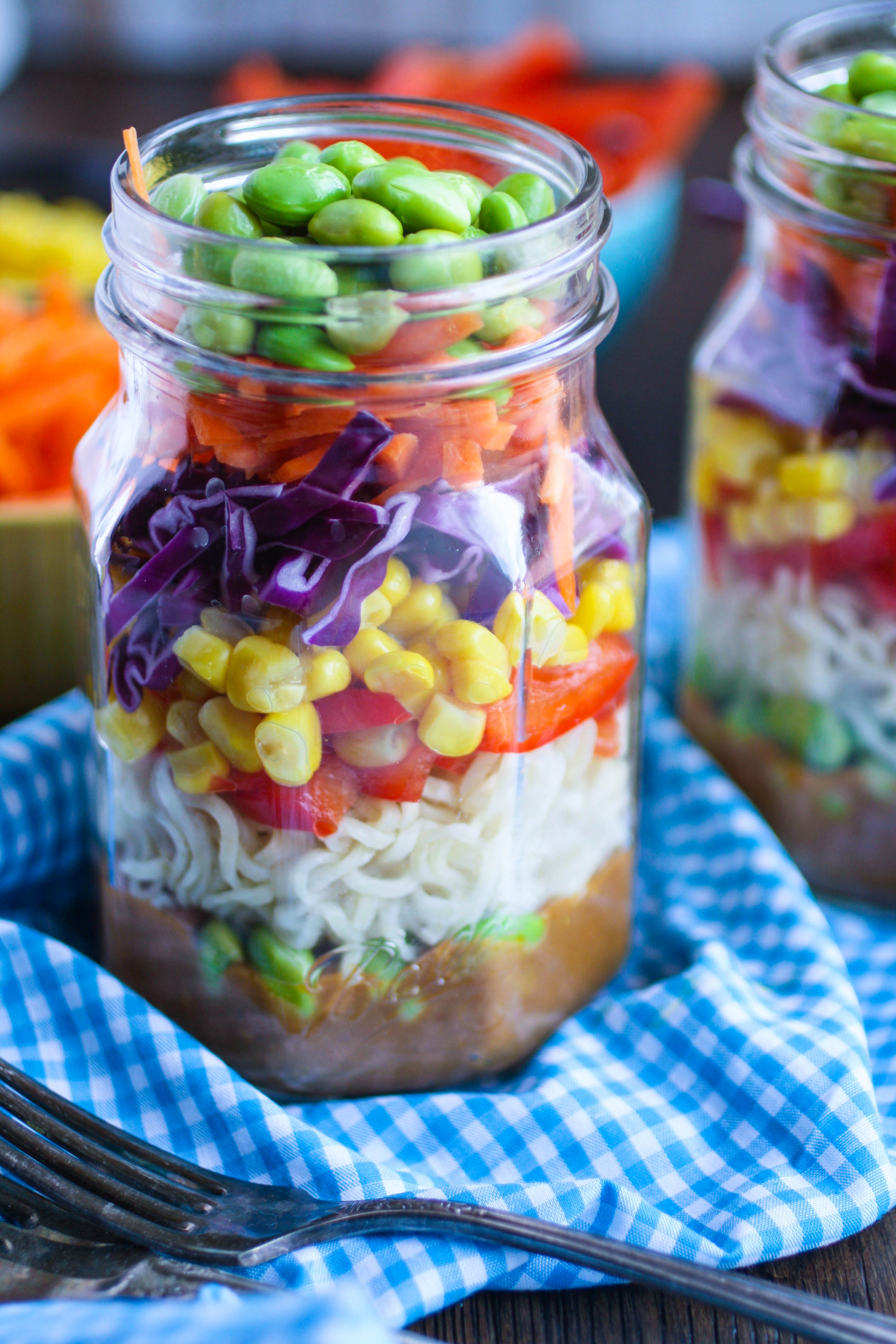 Asian Noodle Salad in a Jar with Spicy Peanut Dressing offers great color and flavors. It's convenient to pack, and delicious to eat!