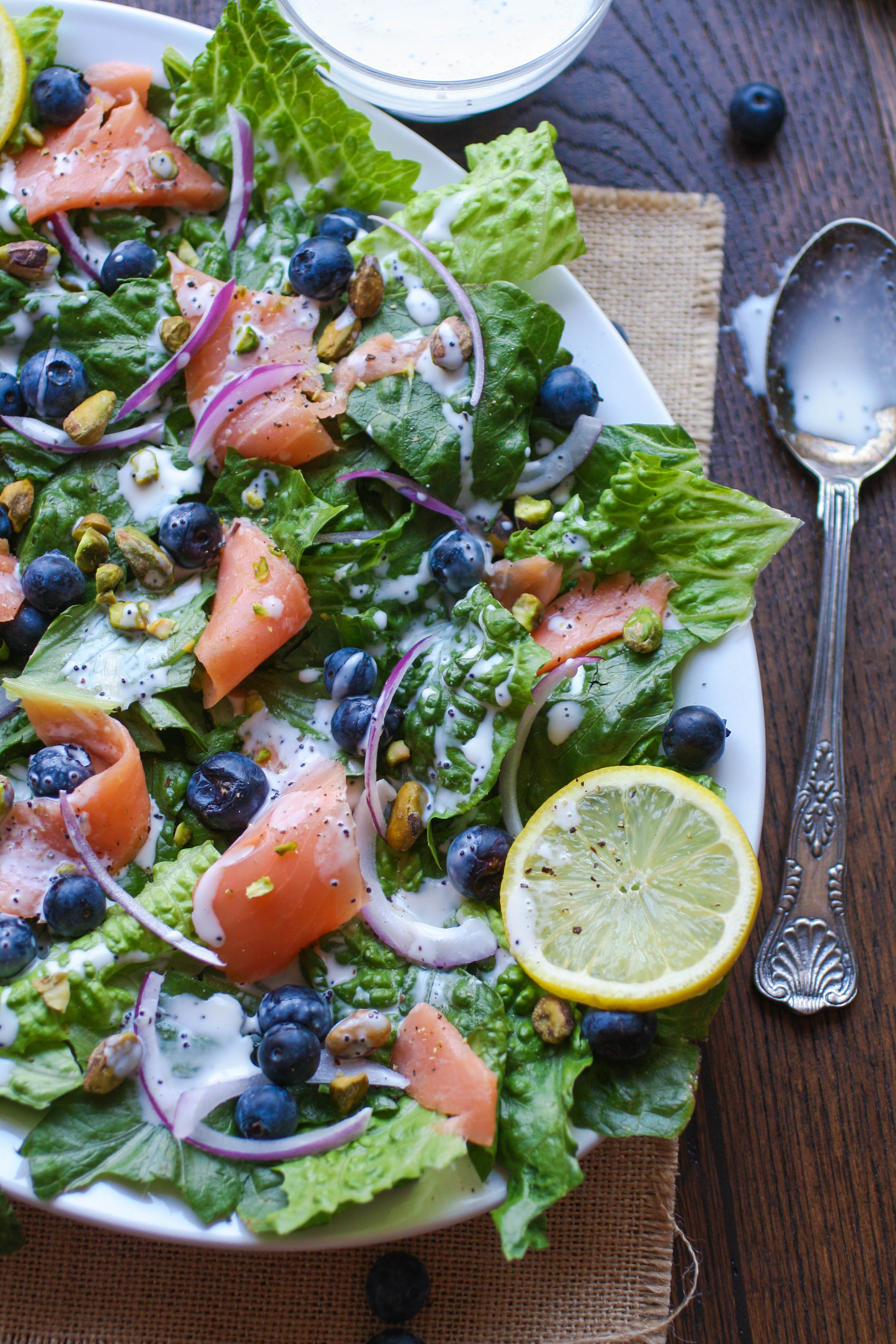 Smoked Salmon Salad with Blueberries and Lemon Poppy Seed Dressing is a great summertime meal. You'll love the salad and the easy-to-make dressing!
