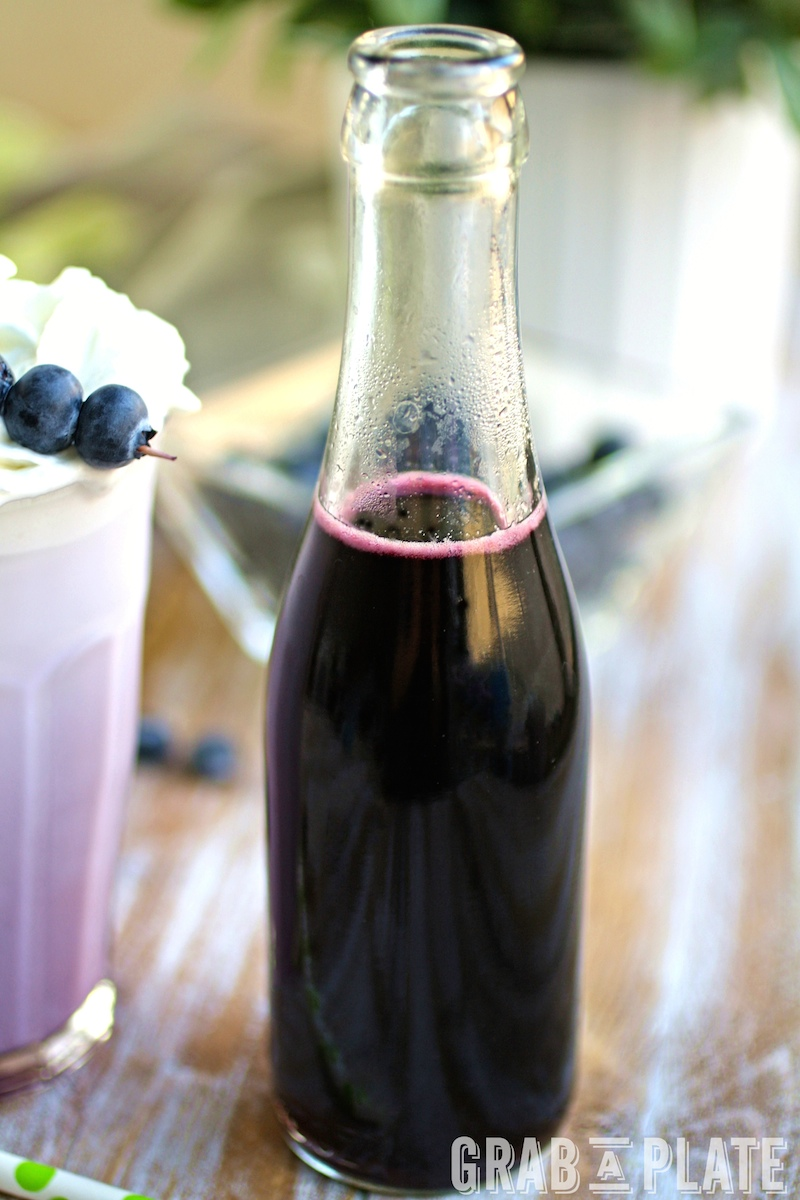 A bottle of homemade Blueberry Simple Syrup