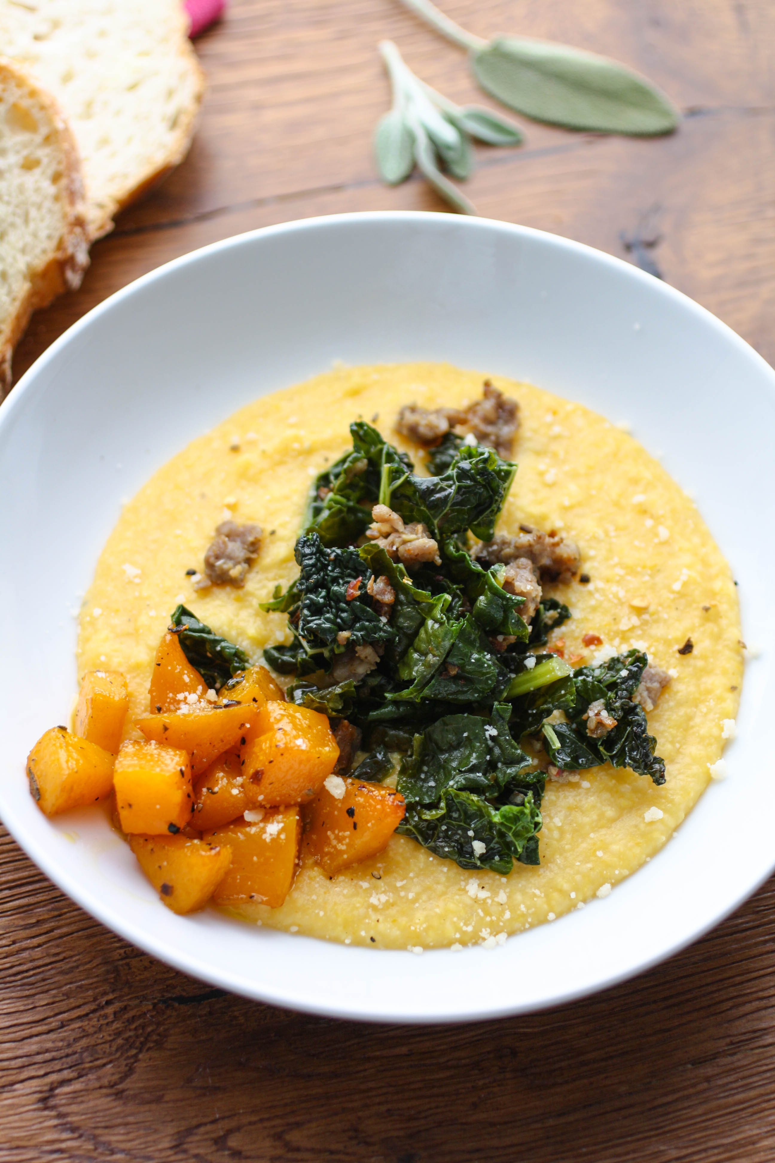 Butternut Squash Grits with Sausage and Kale is a comforting and delicious dish. You'll enjoy serving this grits dish on a chilly night.