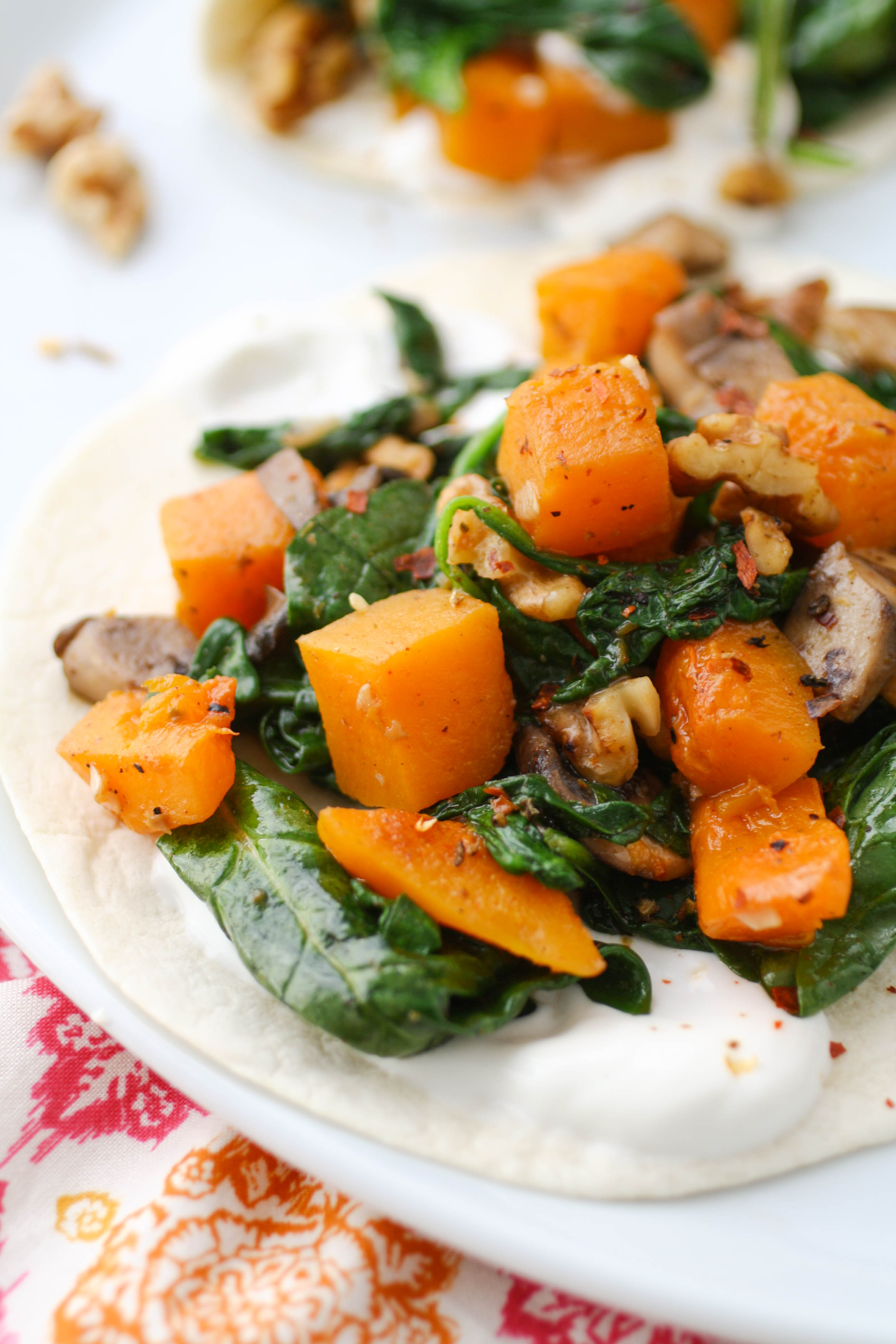 Butternut Squash, Spinach, and Mushroom Tacos are a seasonal favorite! You'll love these tacos any night of the week, but they're fab for a Meatless Monday!