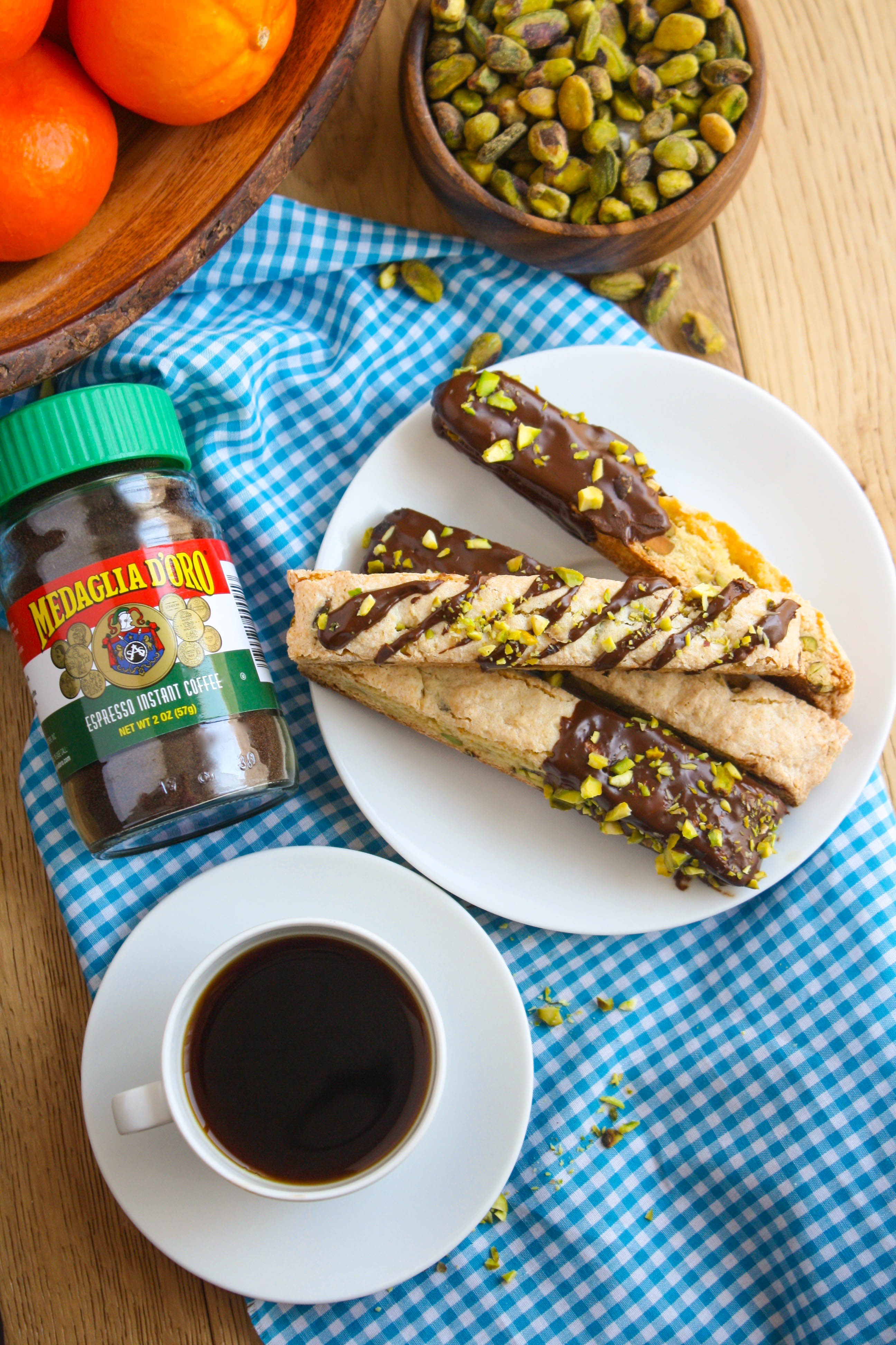 Chocolate-Espresso Dipped Orange and Pistachio Biscotti cookies are an Italian treat you'll love. These dessert cookies are fabulous anytime!