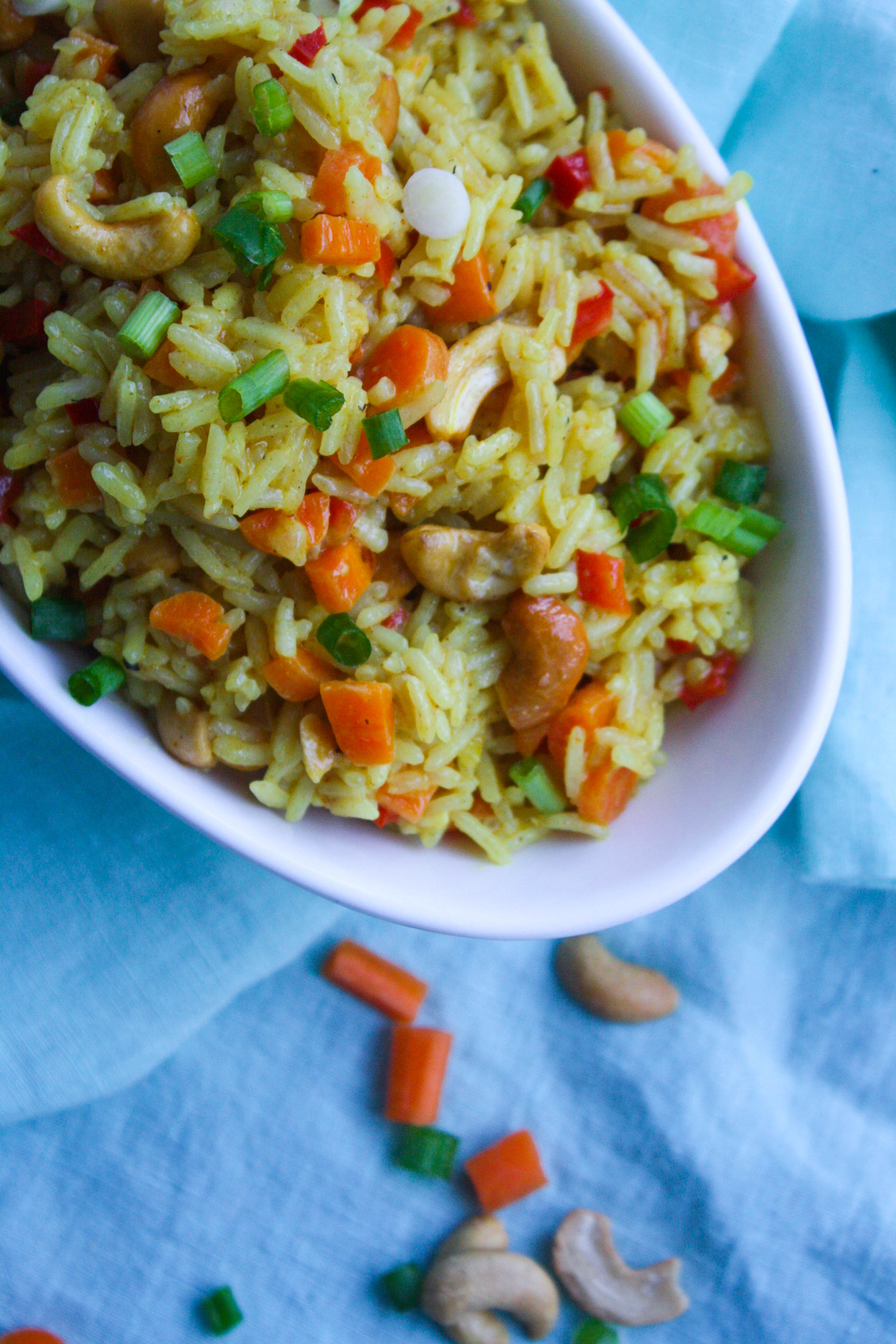 Coconut Carrot and Cashew Rice Pilaf is a fabulous and flavorful side dish. You'll love how easy this rice pilaf is to make, too!