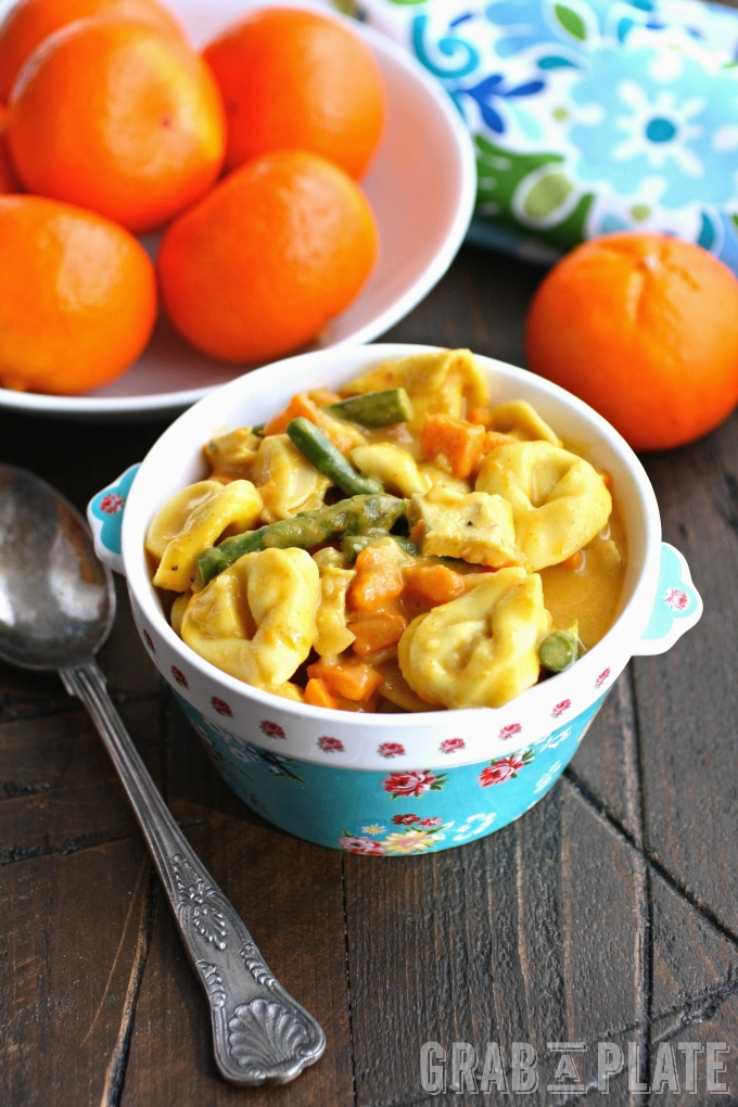 Enjoy a bowl of Creamy Curried Veggie & Chicken Tortellini Soup for a hearty and flavorful meal!