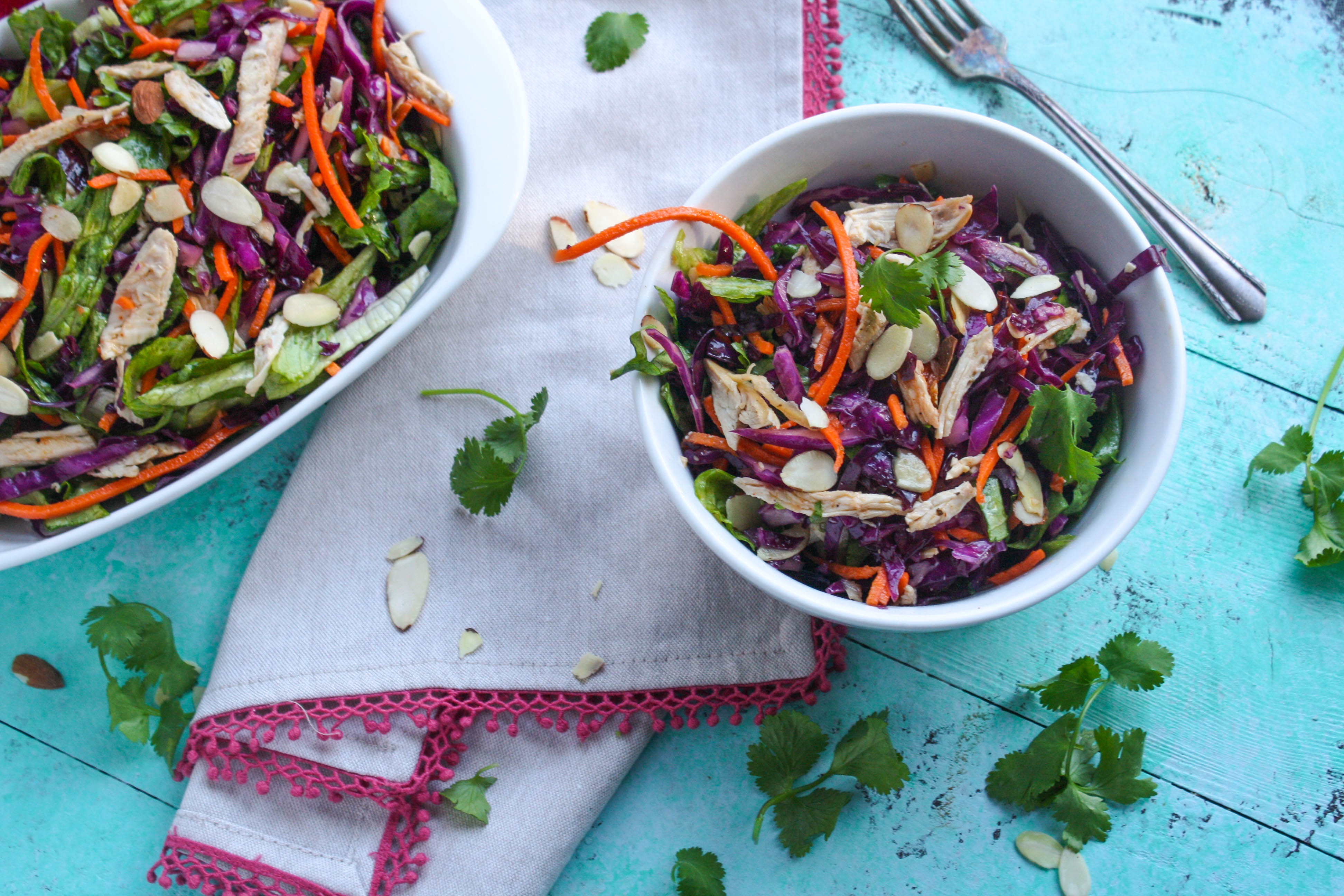 Crunchy Cabbage & Chicken Salad with Sesame Dressing is full of flavor...and crunch! You'll love this tasty and colorful cabbage salad!