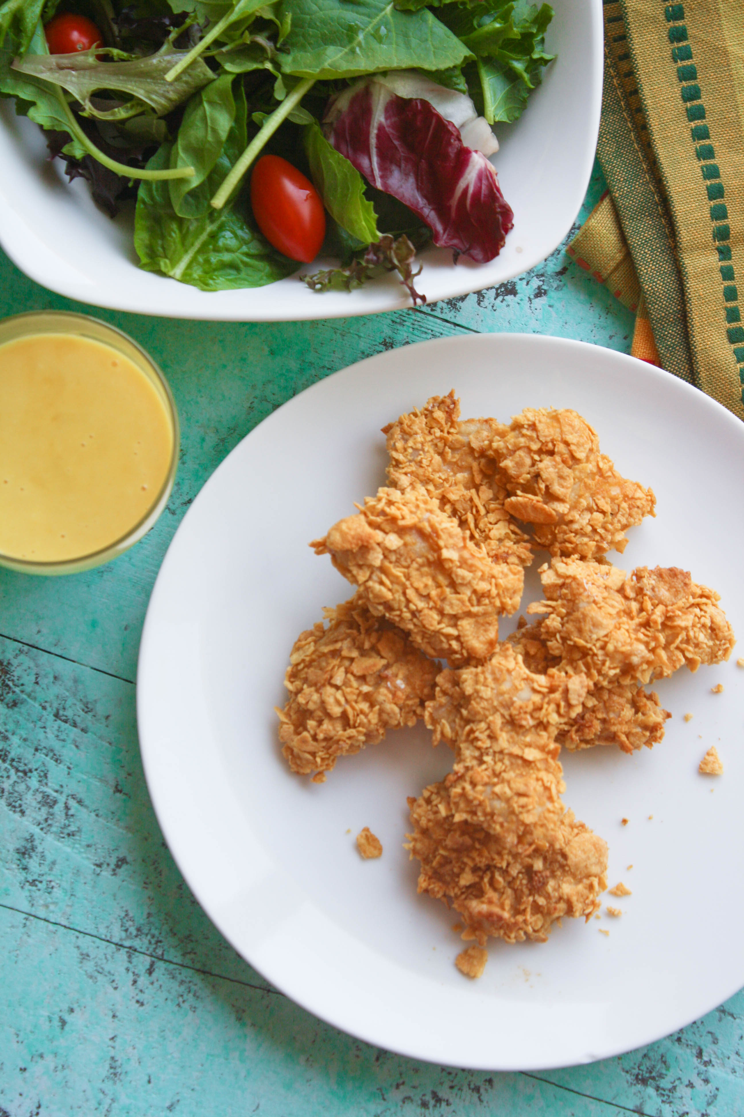 Crunchy Oven Baked Chicken Nuggets with Honey Mustard Sauce makes a fun meal. Try them for dinner soon!