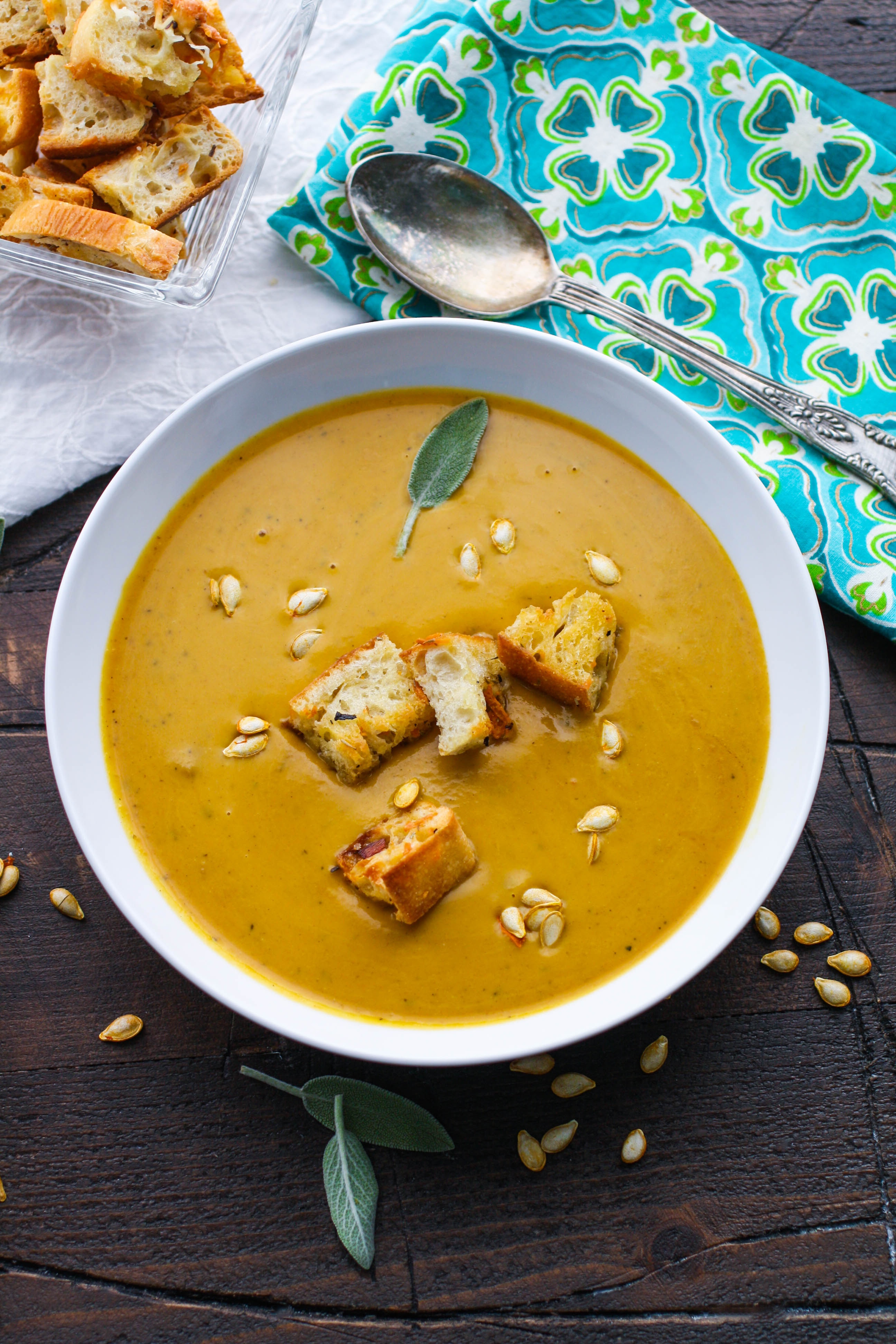 Easy, Creamy Butternut Squash Soup is a bowl of goodness you'll love! The color and flavor of this soup is wonderful!