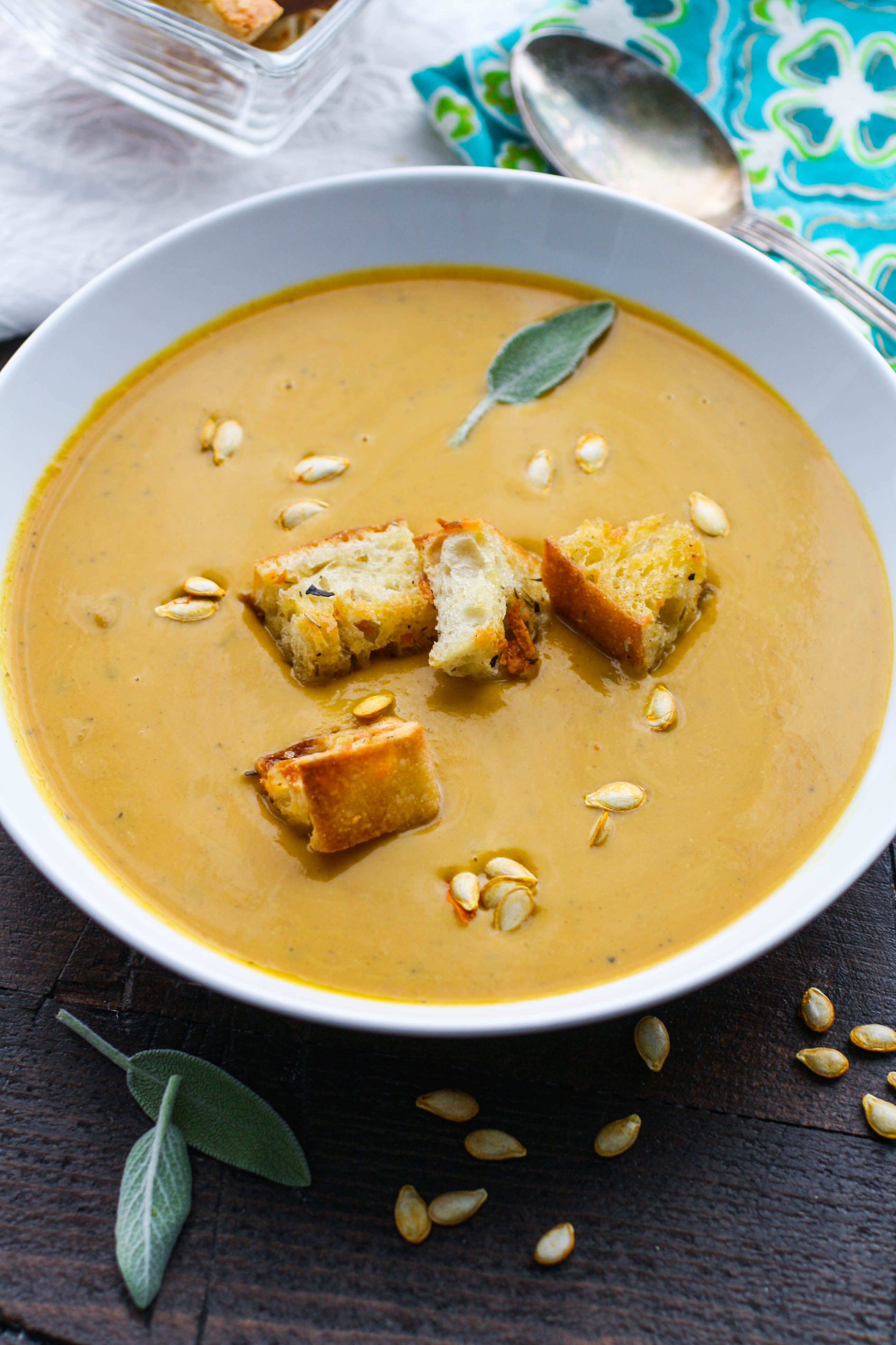 Easy, Creamy Butternut Squash Soup is one you'll want to serve all winter. The colors and flavors of this soup are lovely!