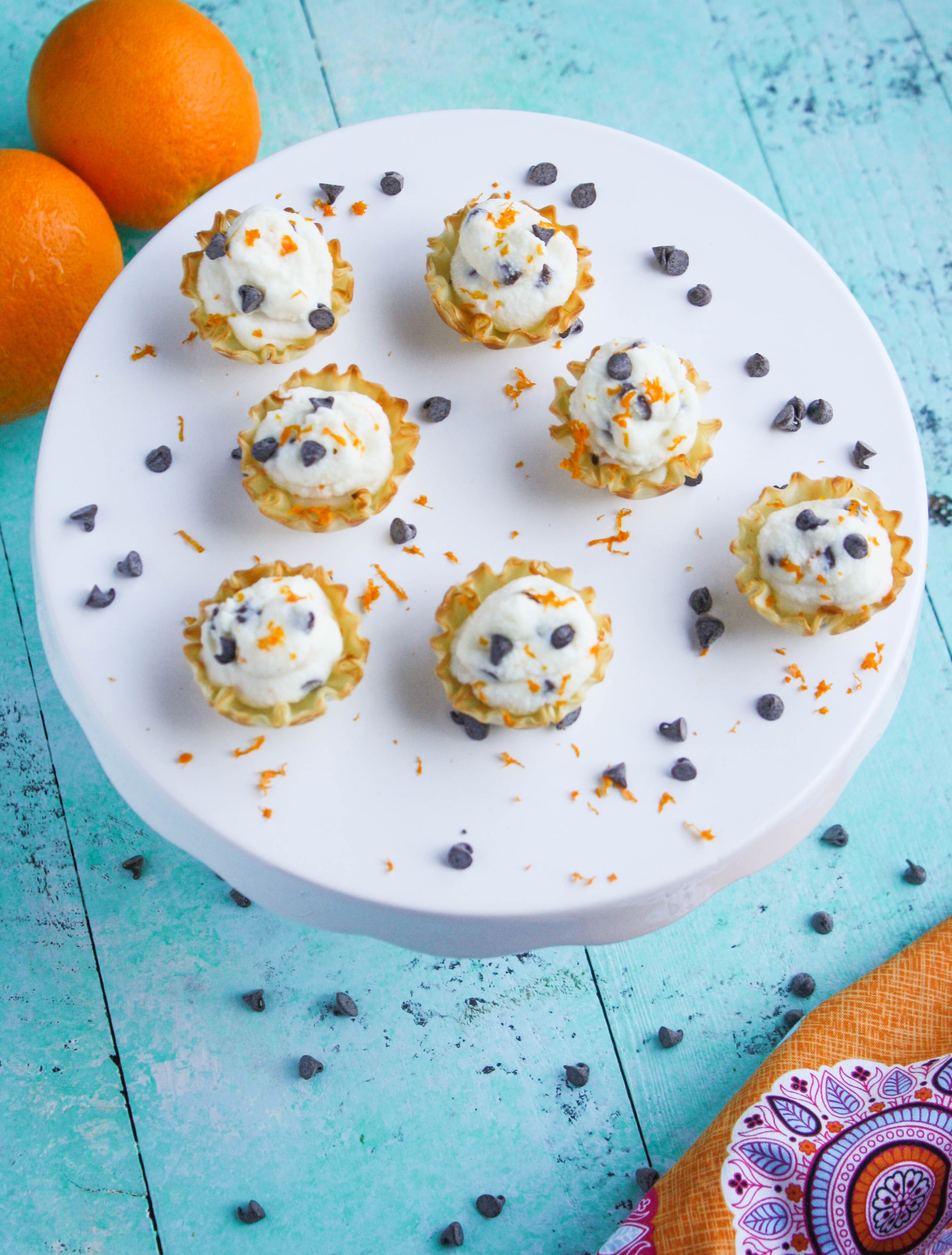 Easy Chocolate Chip-Orange Cannoli Cups are a fabulous treat and so easy to make, too! You'll love these cannoli cups for a special treat!