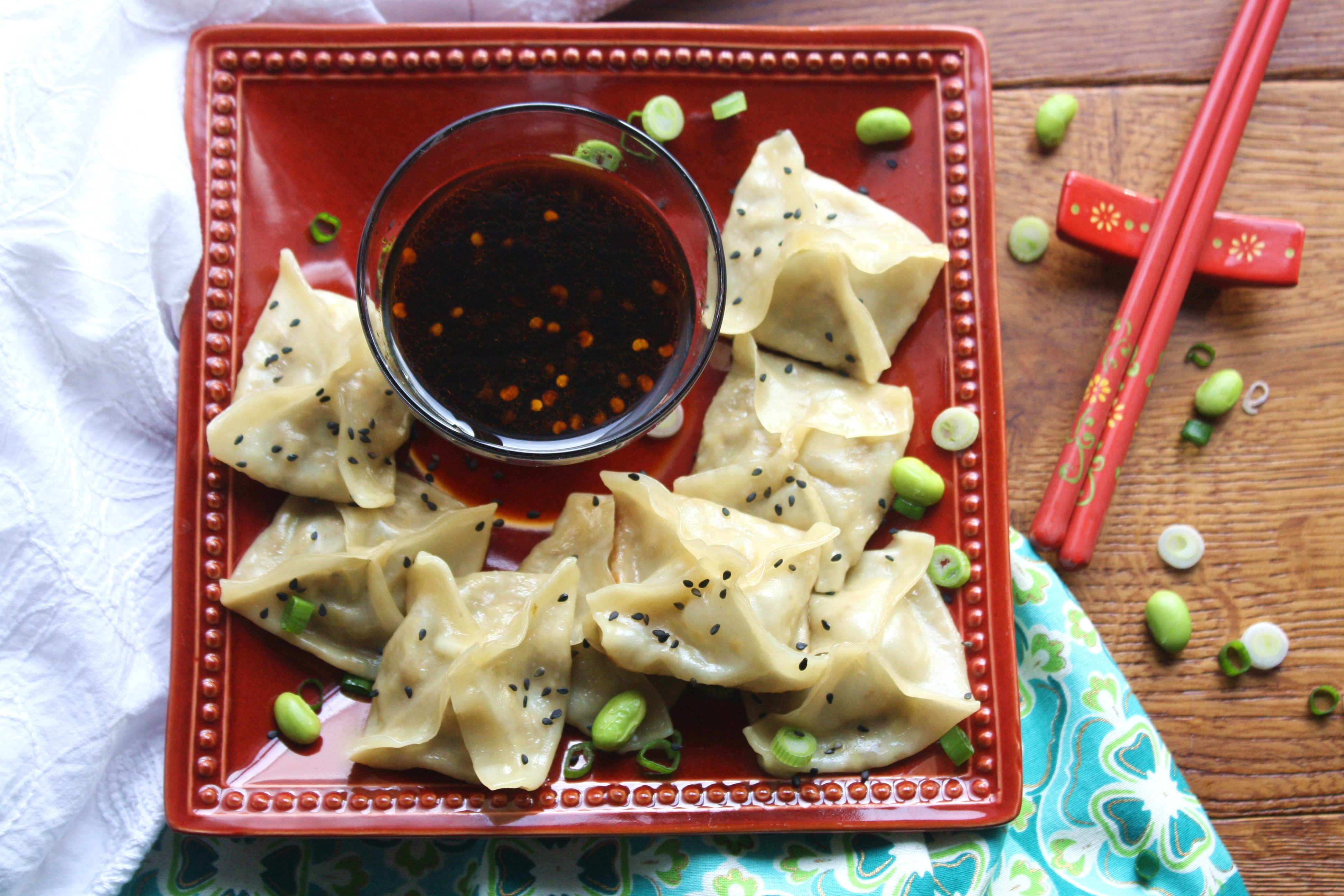 Edamame and Mushroom Potstickers with Dipping Sauce make a yummy snack. You'll love these potstickers with they're tasty dipping sauce!