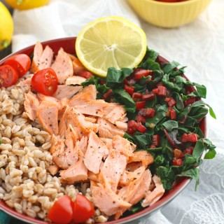 Indulge in a healthy, tasty bowl meal like Warm Farro, Salmon & Swiss Chard Bowls with Lemon Vinaigrette