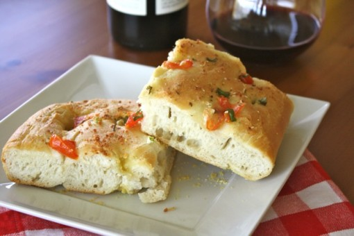 Try a piece of flavorful Focaccia with Tomato, Green Onion and Garlic