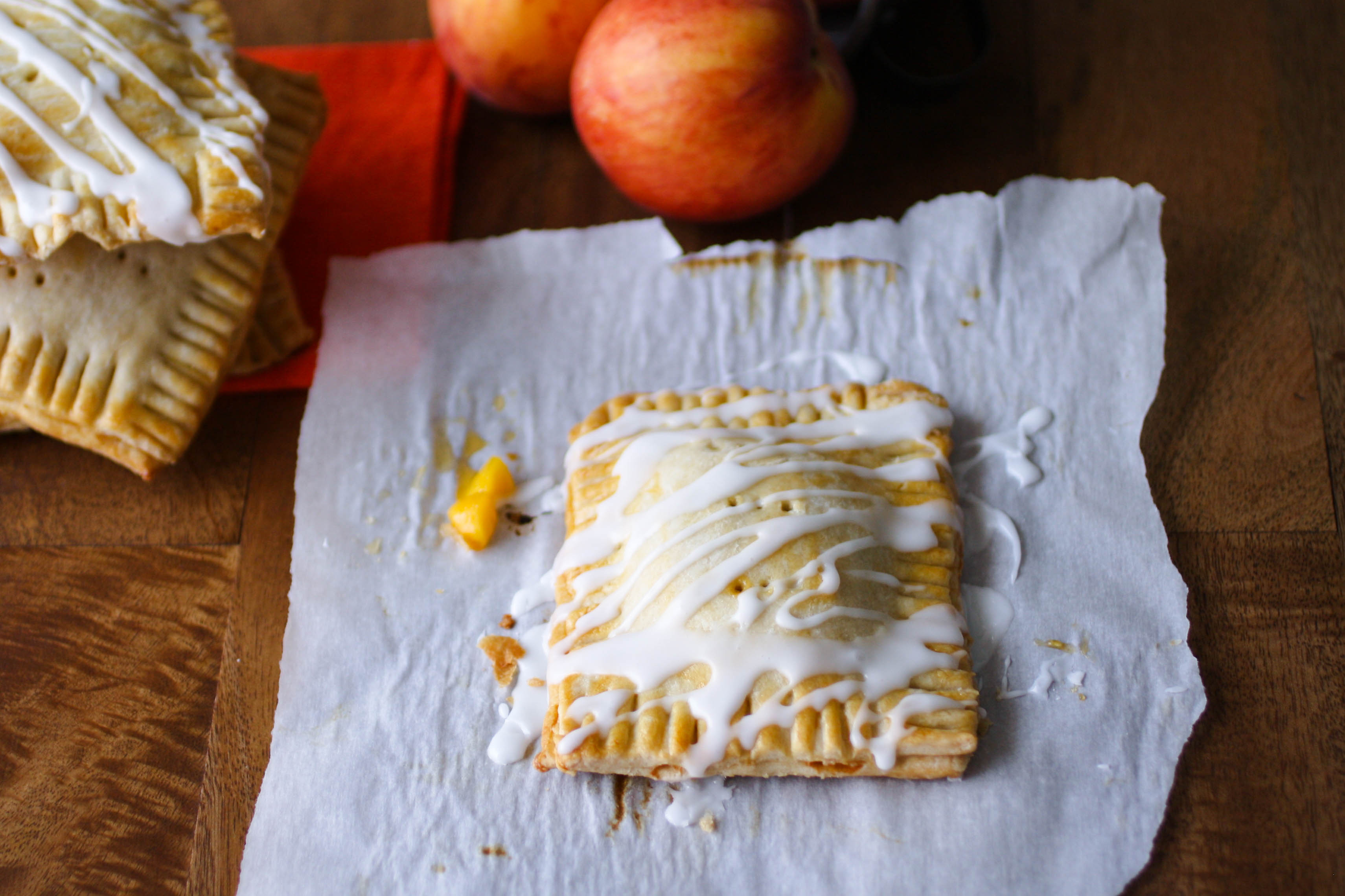 "Fresh Peach Pie ""Pop Tarts"" are flaky on the outside, and filled with fresh peaches. You'll love them!"