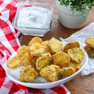 Fried Pickles with Homemade Buttermilk Ranch Dressing are the perfect snack to much on at any gathering. You'll love these pickles as a snack on the weekend!
