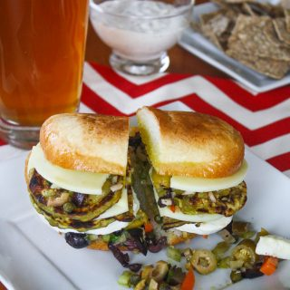 Eggplant Muffuletta Sandwiches are a meatless version of the classic. You'll love these vegetarian muffuletta sandwiches stuffed with eggplant.
