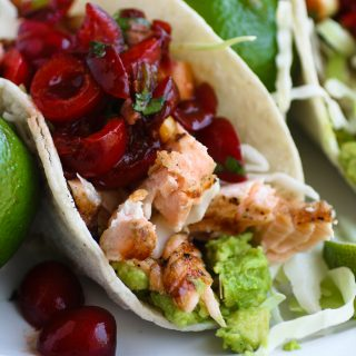 Grilled Salmon Tacos with Fresh Cherry-Chipotle Salsa is perfect for Taco Tuesday or any other day! You'll love the salmon with the zingy salsa, perfect for grilling season.