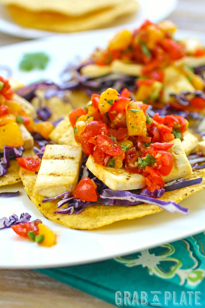 Grilled Tofu Tostadas with Tomato-Mango Salsa are deliciuos any day of the year. They're both meatless and flavorful!