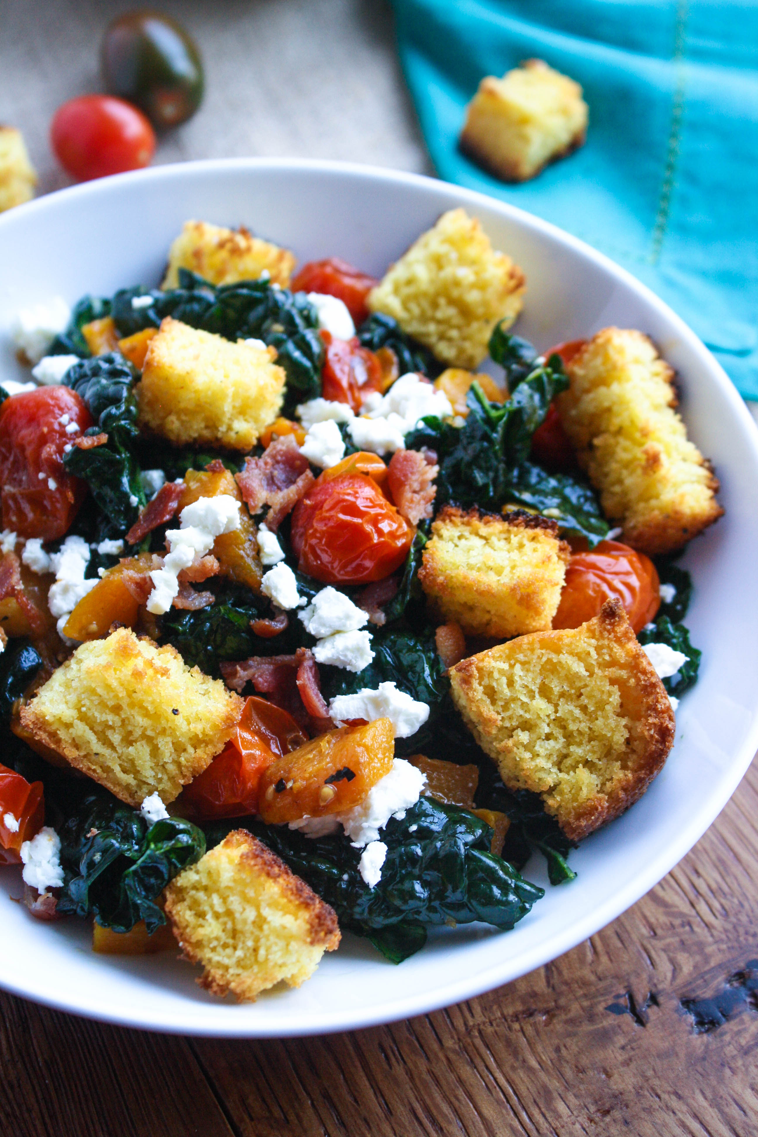 Kale and Cornbread Crouton Salad is a welcome dish the day after Thanksgiving. Use some leftovers to make the cornbread croutons for this wonderful kale salad!