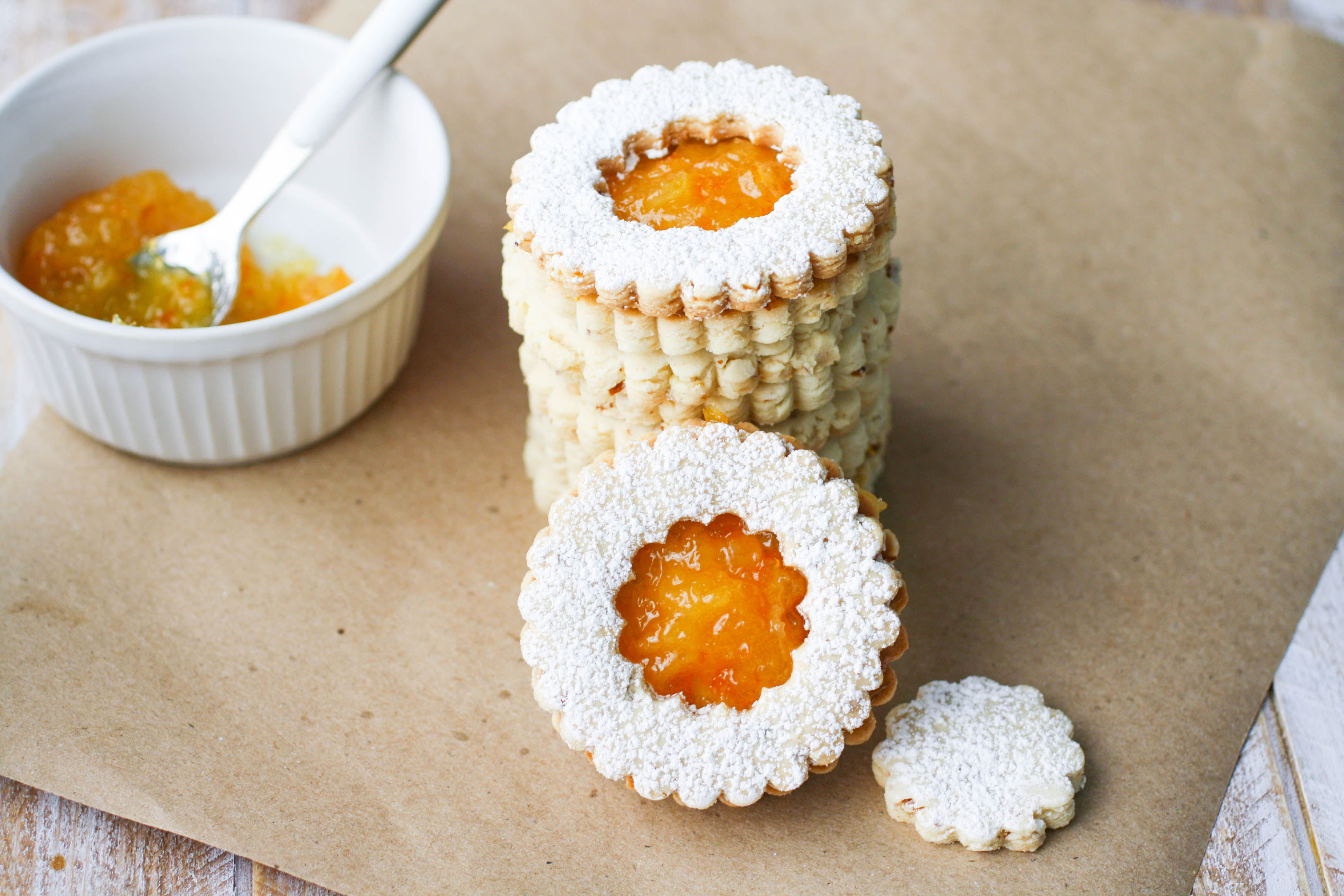 Linzer Cookies with Homemade Orange Marmalade are a lovely cookie to serve during the holiday season. These linzer cookies are pretty, and easy to make, too.