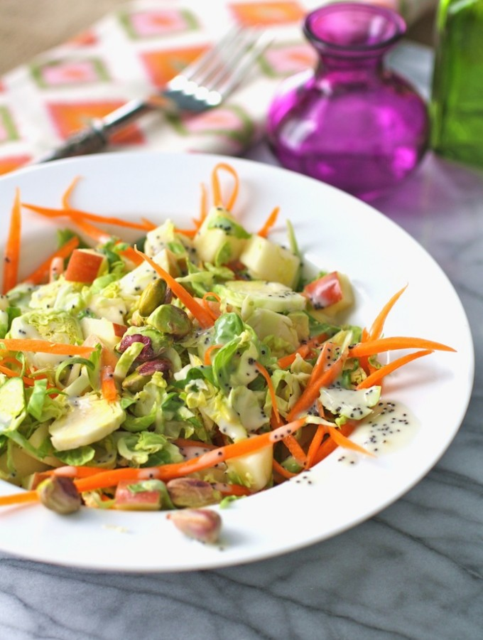 Brussels sprouts salad with carrots, apples, pistachios & poppy seed dressing