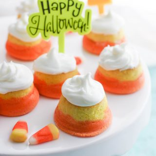 """Mini """"Candy Corn"""" Cupcakes with Buttercream Frosting is a tasty Halloween dessert. You'll love the look and taste of these cupcakes!"""