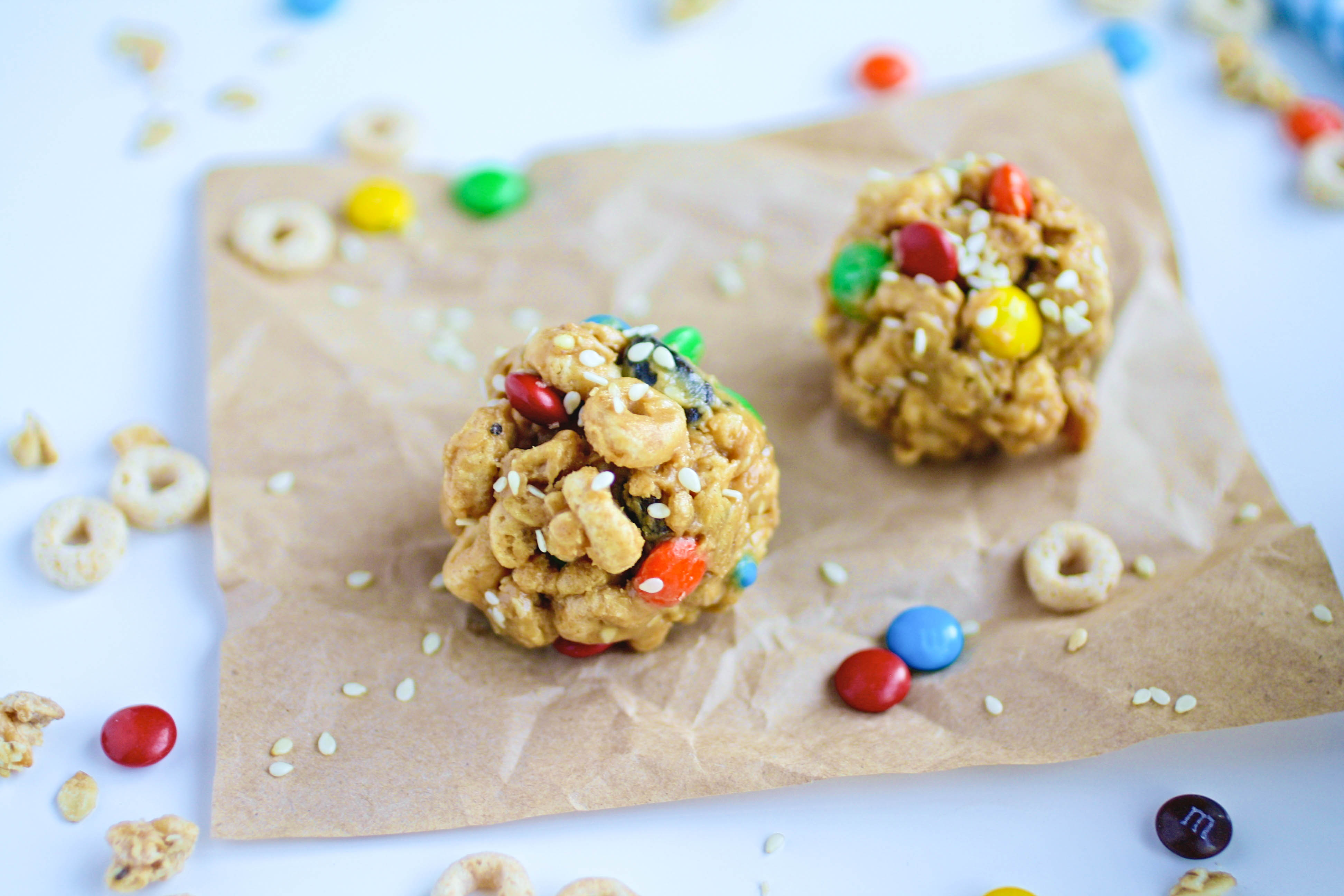 No-Bake Monster Cereal Bites taste the best with friends! These snacks are so fun and easy to make!