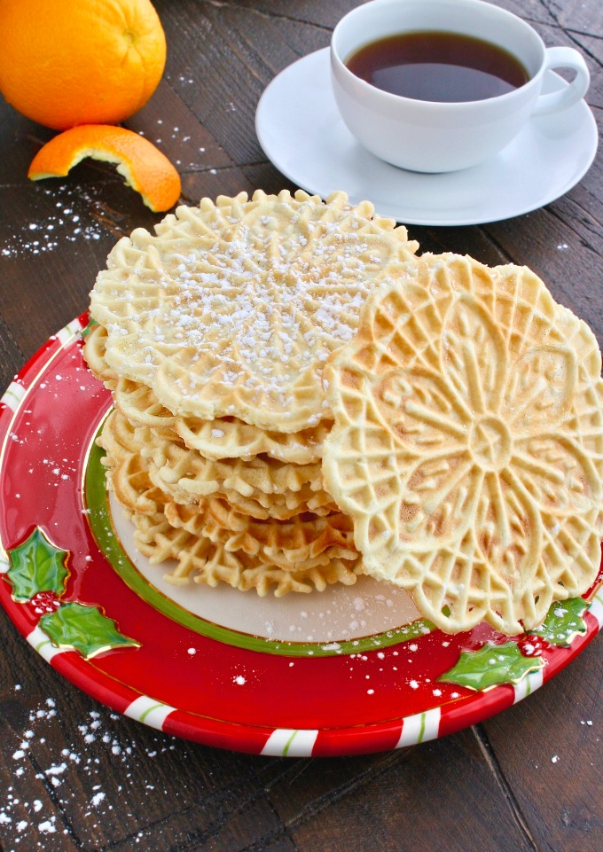 Pile the cookies high! Orange-Amaretto Pizzelle Cookies are fabulous for the season!