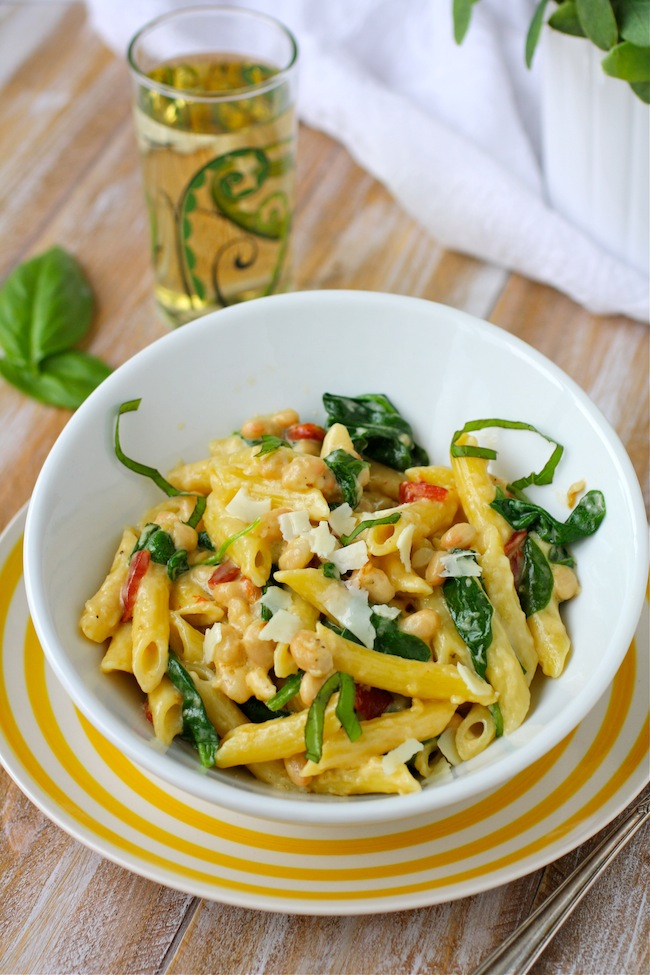 UncommonGoods Floral Wine Glass with a bowl of Creamy Pasta with White Beans and Spinach