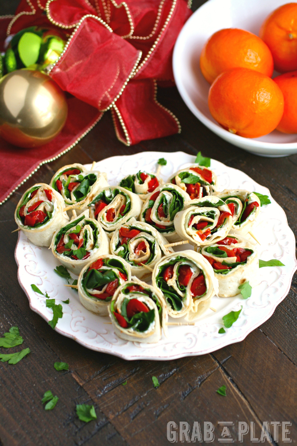 Serve up a platter of Easy Swiss, Spinach, and Red Pepper Pinwheels - so easy for entertaining!