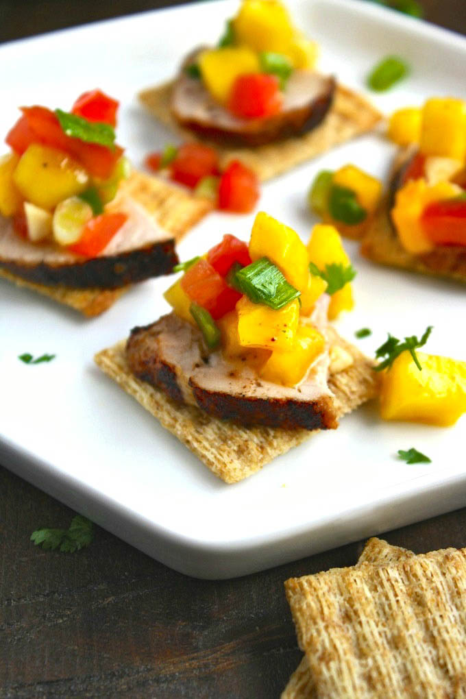 Pork Tenderloin Bites with Mango Salsa is a unique appetizer. Put the chips away and try this dish instead!