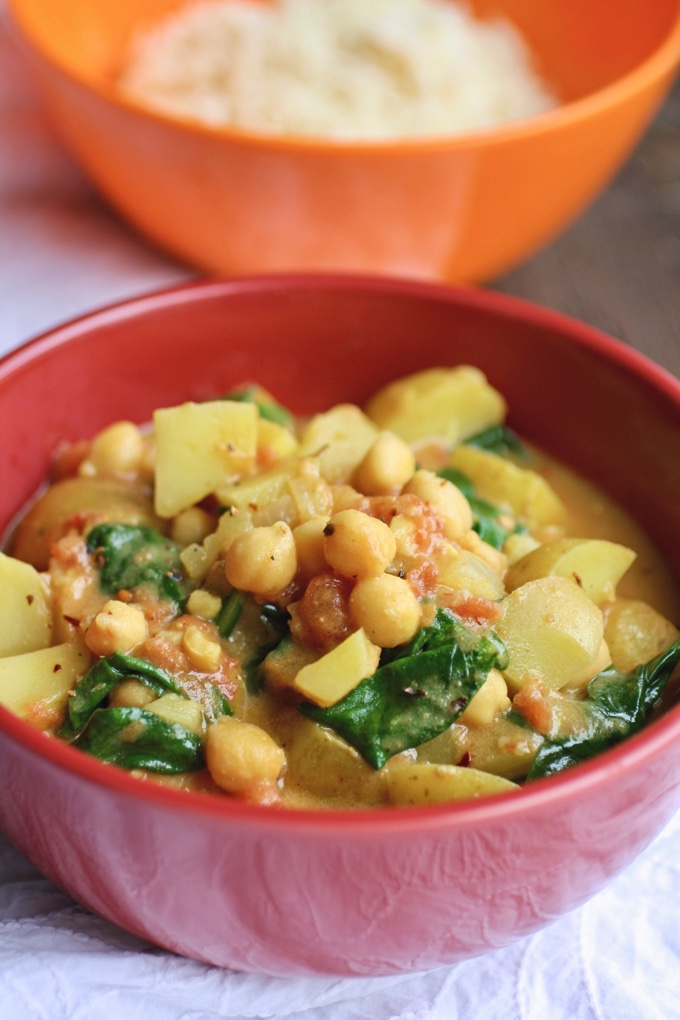 Potato, Chickpea, and Spinach Curry is filling and flavorful. You'll love this meatless and vegan dish!