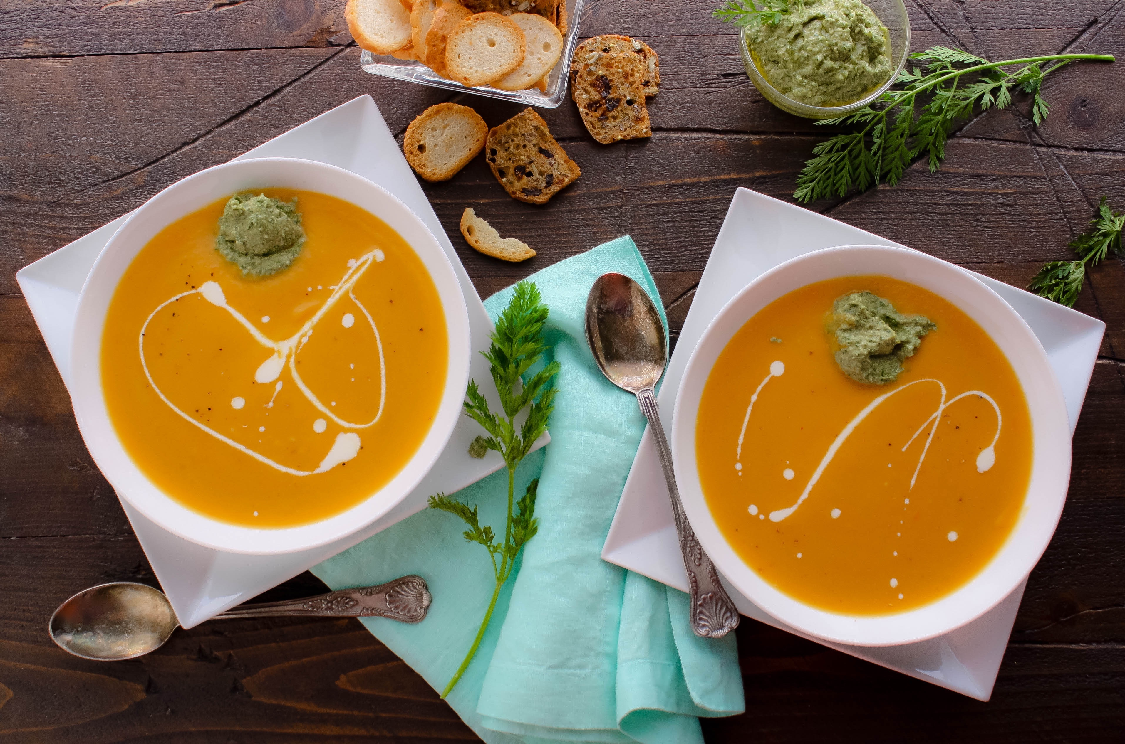 Roasted Carrot and Parsnip Soup with Carrot Greens Pesto is creamy and delicious. You'll love Roasted Carrot and Parsnip Soup with Carrot Greens Pesto for any night of the week.