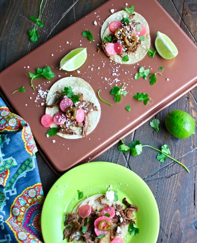 You'll really enjoy these Slow Cooker Beef Carnitas Tacos with Spicy Pickled Radishes!