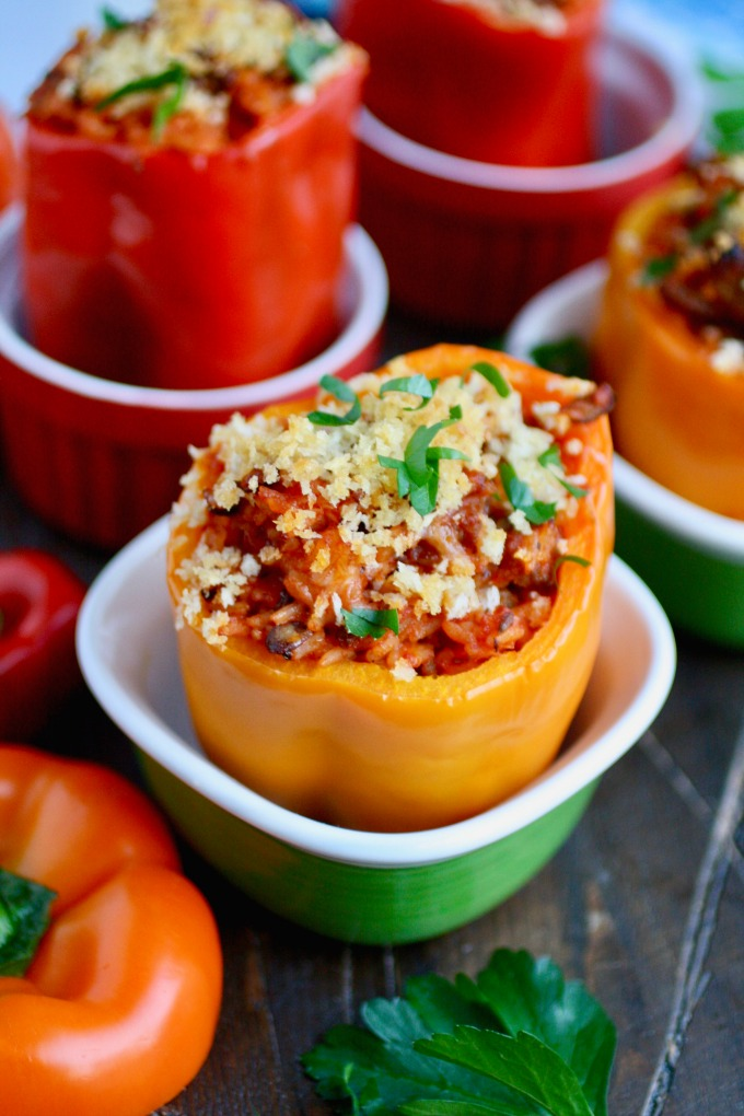 One bite and you'll love these Spicy Sausage and Rice Stuffed Peppers!