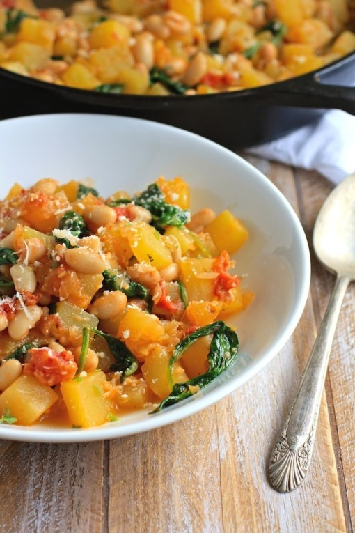 a bowl of winter squash, white bean and spinach saute