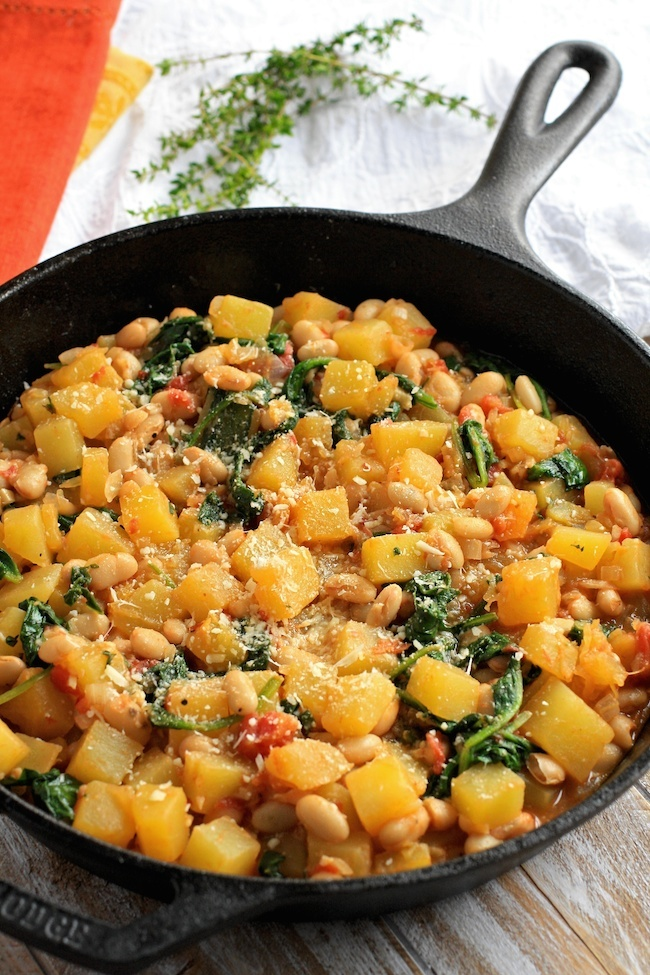 Winter squash, white beans, and spincah saute in a skillet