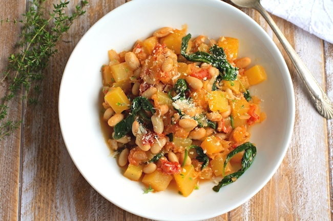 A bowl of winter squash, white bean, and spinach saute