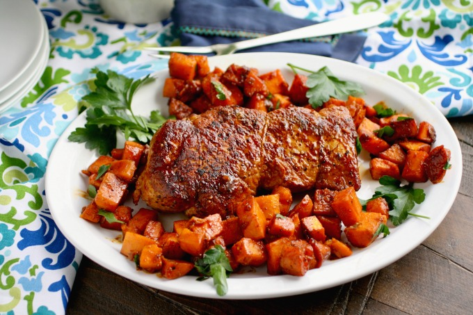 You'll love how easy it is to make Sriracha-Roasted Pork with Sweet Potatoes (just 4 ingredients)! It's delicious, too!