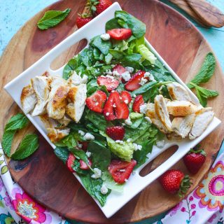 Chicken Salad with Strawberries and Honey-Lemon Mint Dressing is a fabulous salad to try this season. You'll love the homemade dressing, sweet strawberries, and how easy it is to make!