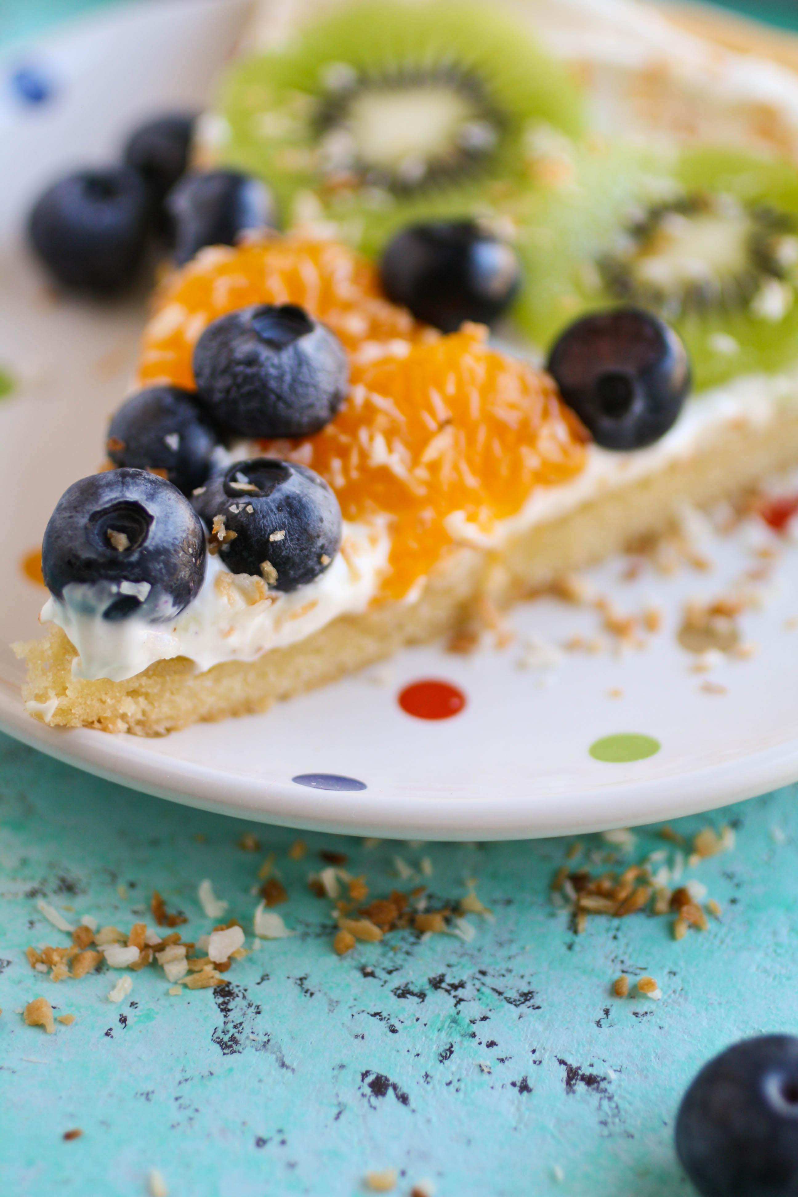 Sugar Cookie Fruit Pizza is a sweet pizza treat! You'll love how easy it is to make this deliciuos dessert!