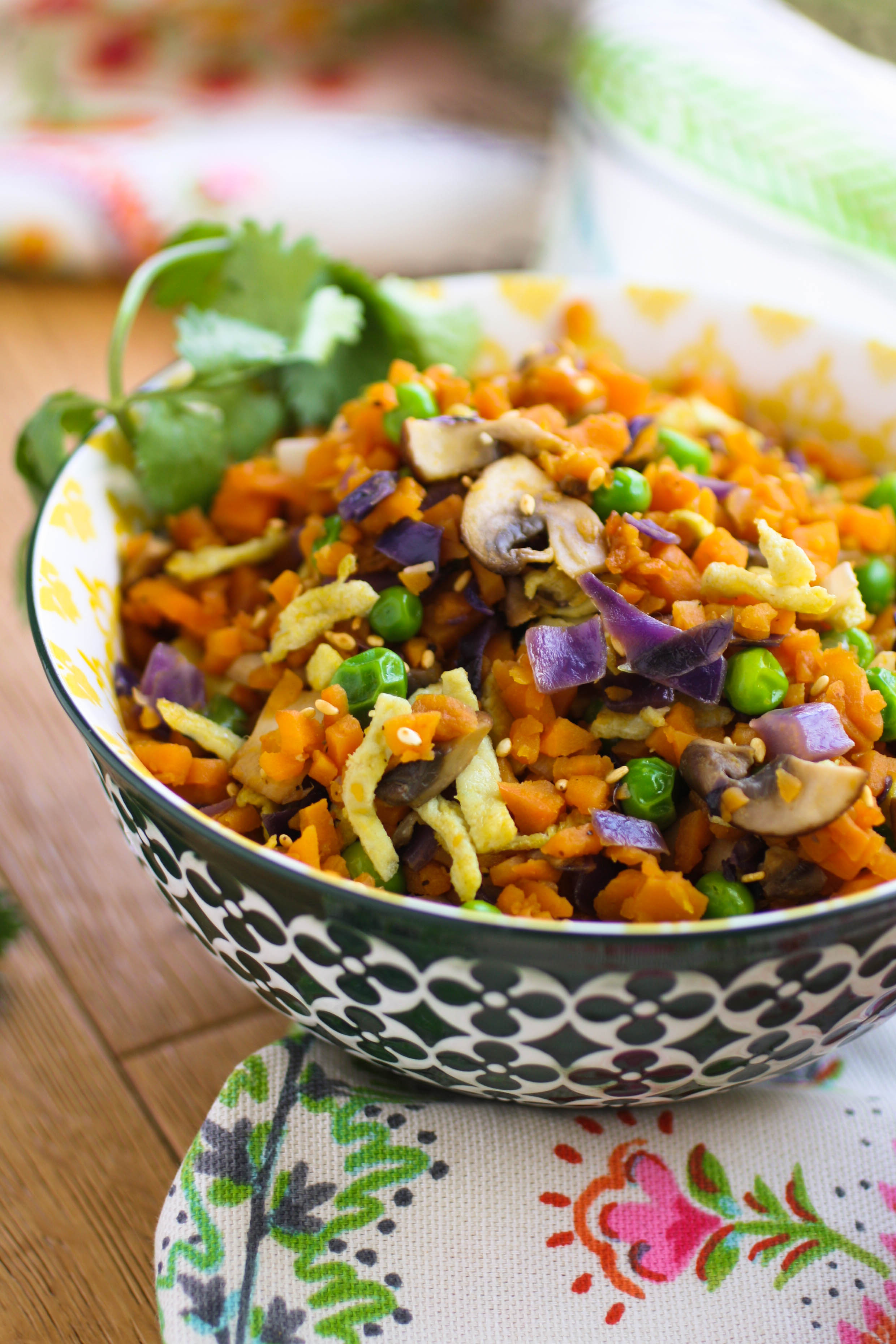 "Sweet Potato ""Fried Rice"" is a healthy and colorful dish. Try this meatless dish for your next side or main part of your meal!"