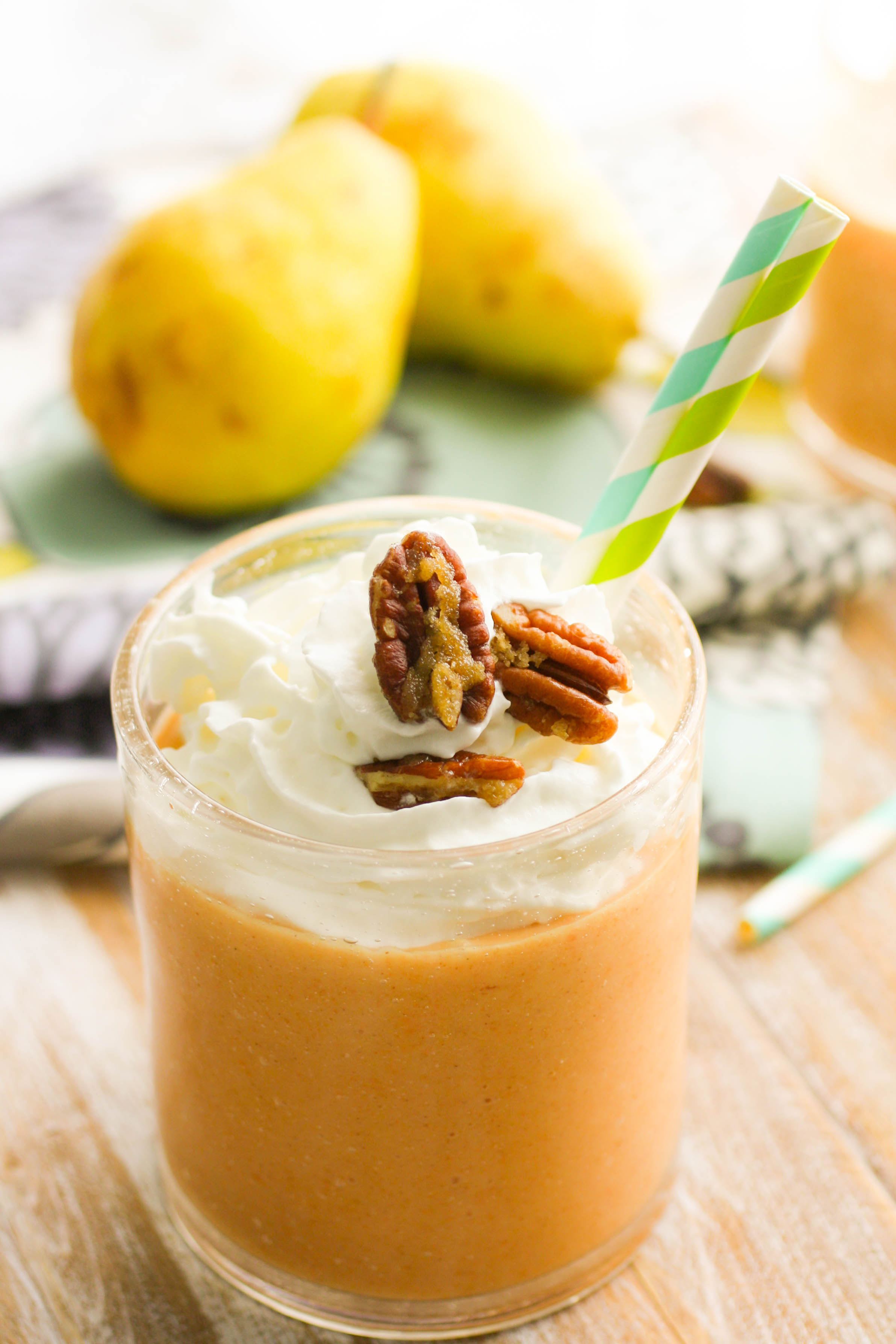 Sweet Potato-Pear Smoothies with Candied Pecans will have you toasting to fall! These smoothies are great in the morning, and make a great dessert, too!