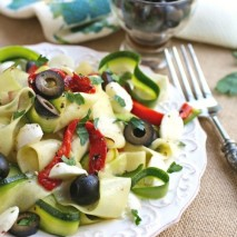 "Dig into a Mediterranean-inspired, seasonal meal: Chilled Zucchini Ribbon ""Pasta"" with Black Olives, Roasted Red Peppers and Mozzarella"