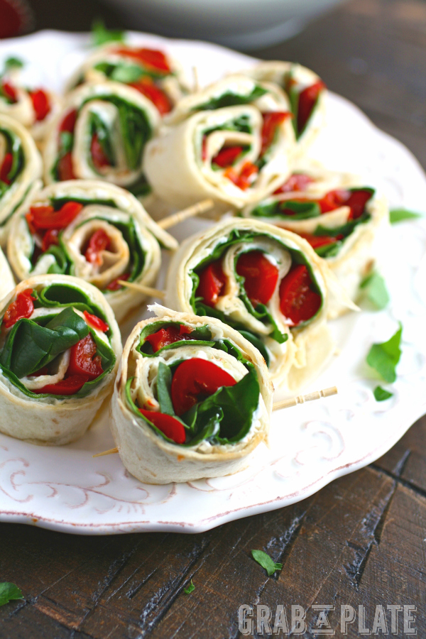 For an easy-to-make appetizer or snack, serve up Easy Swiss, Spinach, and Red Pepper Pinwheels!