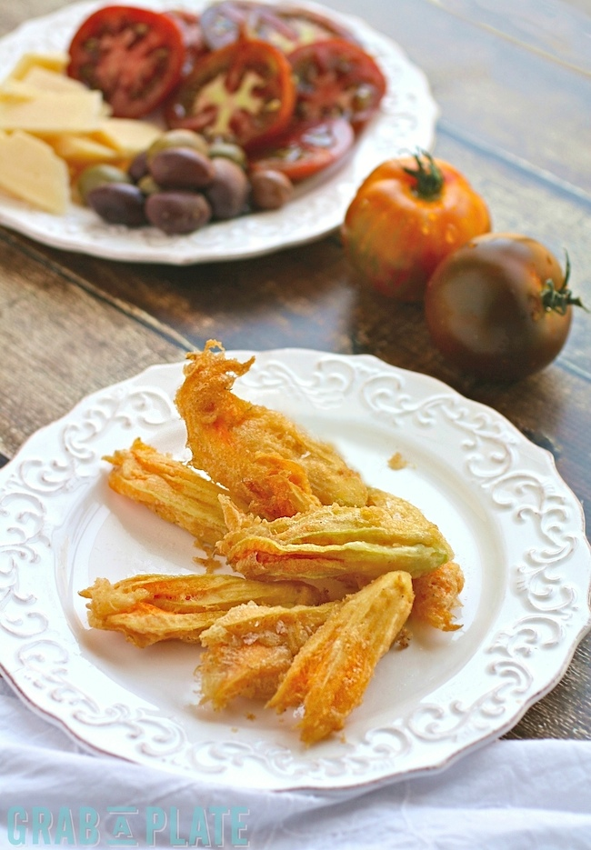Delight in the summer with this appetizer for Fried Zucchini Blossoms