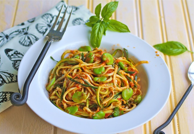 Bolw of zucchini pasta with fava beans and harissa sauce