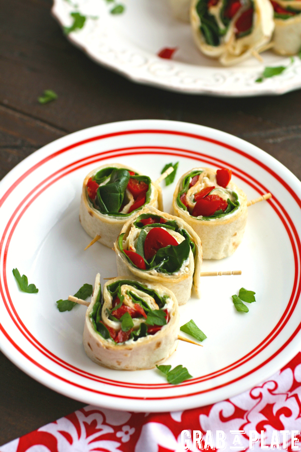 Delight in a plate of Easy Swiss, Spinach, and Red Pepper Pinwheels!