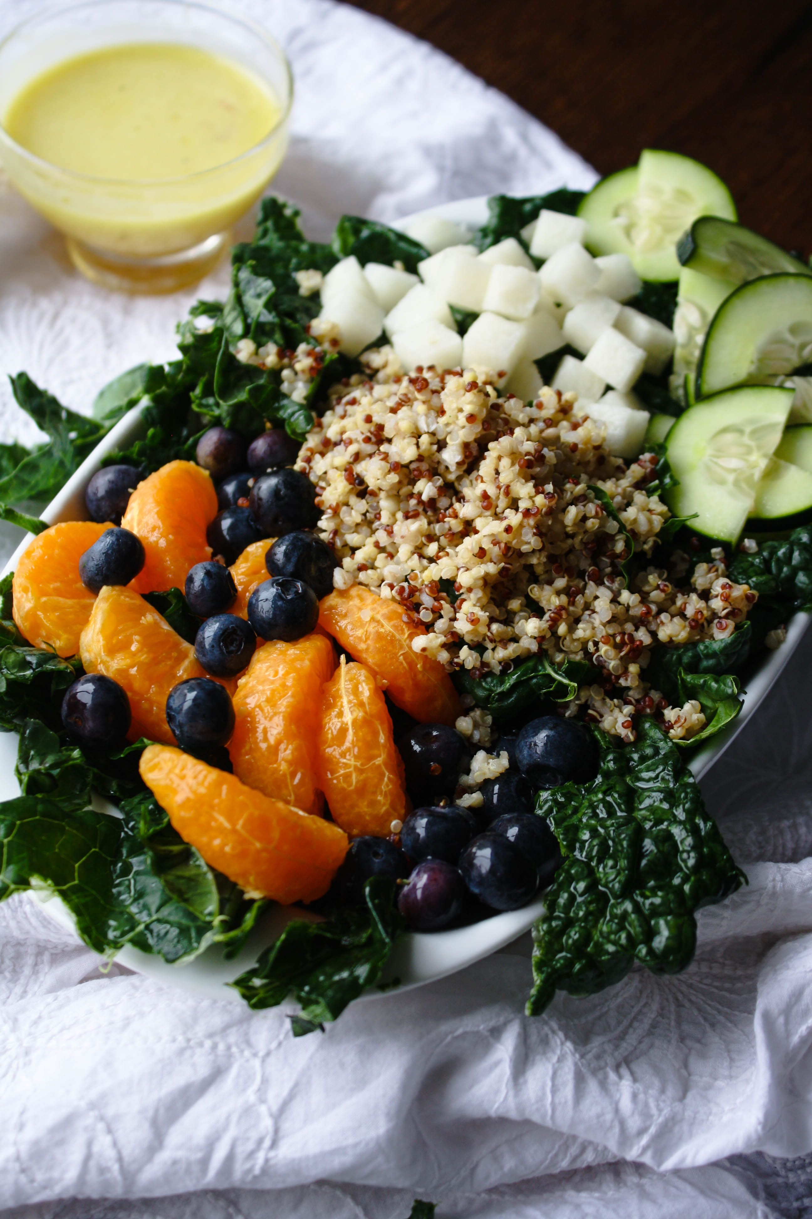Kale-Quinoa Salad with Orange Vinaigrette makes a great meal. This salad is filling, delicious, and healthy!